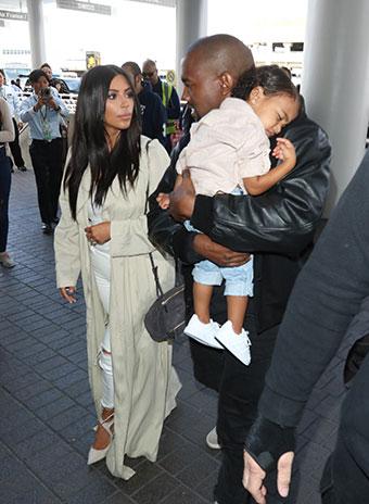 Ким Кардашьян и Канье Уэст с дочерью Норт