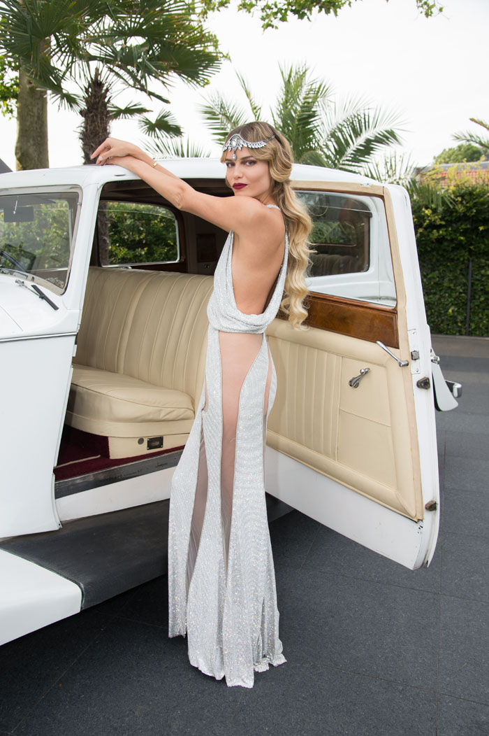Наташа Поли в Versace