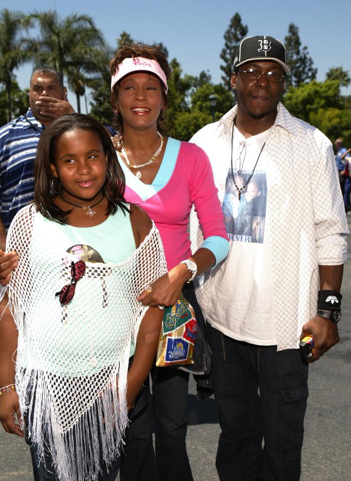 Уитни Хьюстон с мужем и дочерью