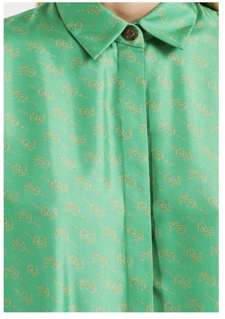 В зеленом струящемся шелке: элегантный шелковый костюм «на все пуговицы» Светланы Ходченковой (фото 5)