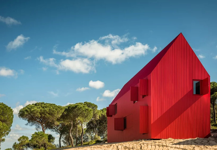 this bright red house in portugal has been designed to stand out (фото 0)