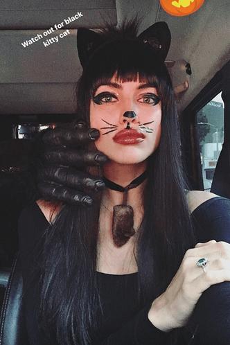Catwoman: сексуальный образ Ирины Шейк по случаю Хэллоуина фото [2]