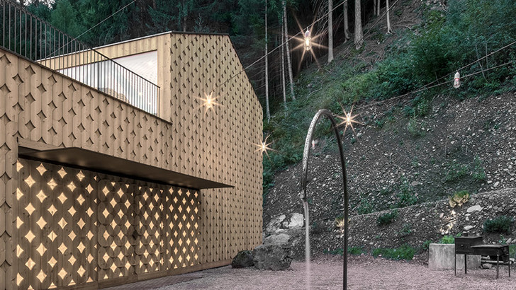 Pedevilla Architects lines cookery school with perforated timber panels (фото 0)
