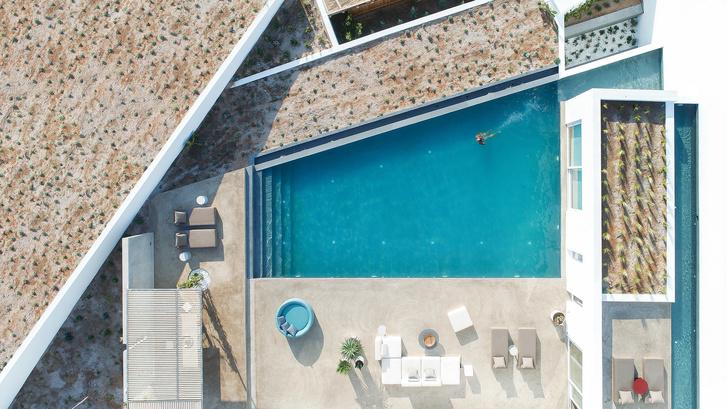 Белоснежная вилла на Санторини от Kapsimalis Architects (фото 28)
