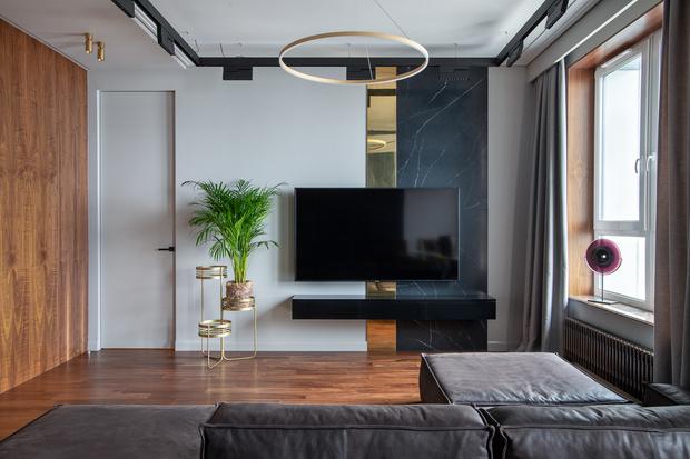 Квартира 80 м² в оттенках натурального дерева и латуни (фото 0)