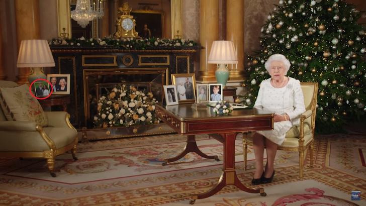 Что делает портрет Меган Маркл на столе Елизаветы II? (фото 1)