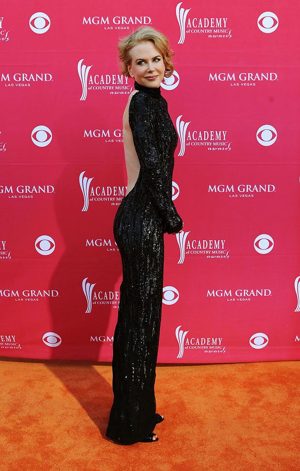 В платье L'Wren Scott, 2011 год