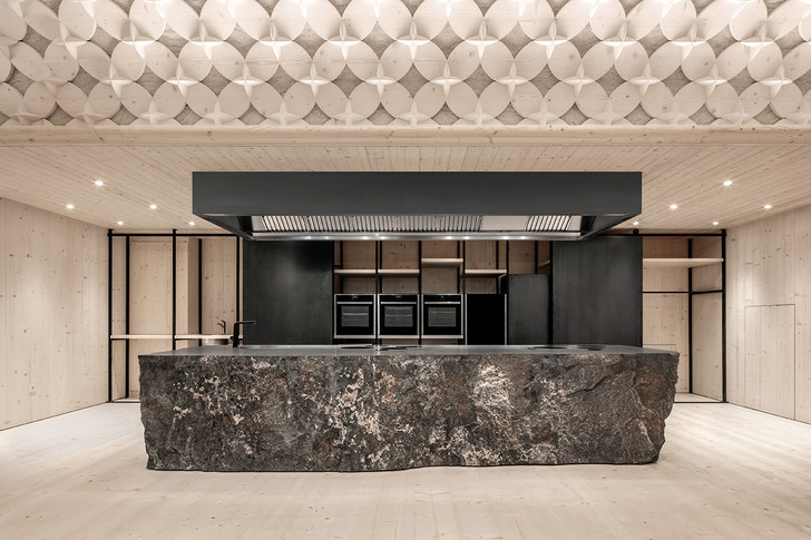 Pedevilla Architects lines cookery school with perforated timber panels (фото 3)