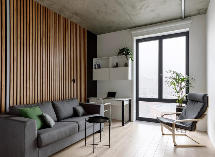 Лаконичная квартира с бетонным потолком и деревянными стенами 71 м² (фото 13)