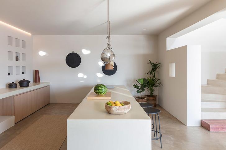 Белоснежная вилла на Санторини от Kapsimalis Architects (фото 27)