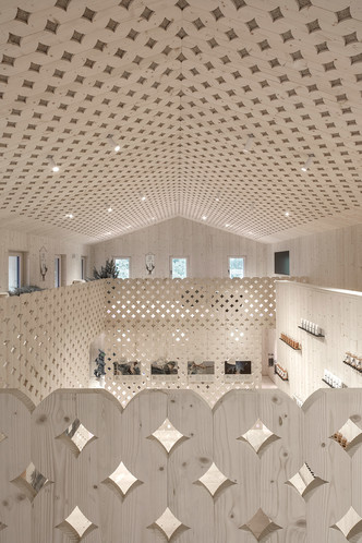 Pedevilla Architects lines cookery school with perforated timber panels (фото 1.2)